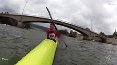 A kayaker paddles in a race on a river. Stock Footage