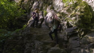 Hiker Poses On A Cliff For Her Friend's Photos, She Shows Off Her Muscles Stock Footage