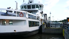 People go on ferry, Helsinki South Harbour, large boat sway near pier Stock Footage