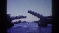 1960: bridge lifted up so boats can travel underneath FLORIDA Stock Footage