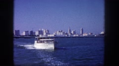 1960: yacht leaving major city FLORIDA Stock Footage