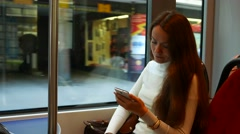 Thoughtful woman stare to smartphone, travel in tram at shopping street Stock Footage