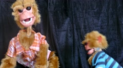 Two monkey marionette Stock Footage