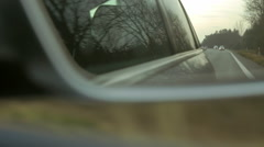 Side-view mirror in a modern car. Driving along the expressway. Stock Footage