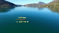 Three kayakers paddle in a scenic mountain lake. Stock Footage