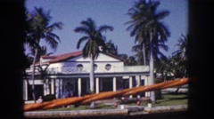 1960: travelling down street in tropical area FLORIDA Stock Footage