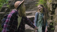 Hiker Convinces Her Friend To Keep Going After A Rest, She Pulls Her Up Off Rock Stock Footage
