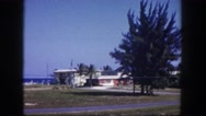 1960: homes in neighborhood along street FLORIDA Stock Footage