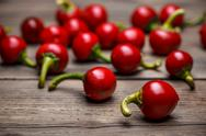Raw hot cherry peppers Stock Photos