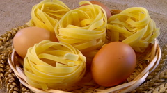 Noodles and chicken eggs in a wicker plate Stock Footage