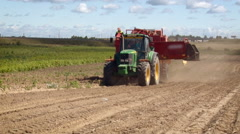 Rural Area. Farming Land. Tractor With Heavy Equipment Moving on Empty Field. Stock Footage