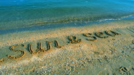 Inscription the sun on sand, the beach. Stock Footage