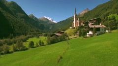Aerial view of Heiligenblut in the Alps Stock Footage