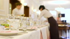 Cutlery on table at restaurant and waiter at background Stock Footage