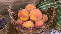 Large ripe peaches in a wicker basket, autumn fair, close-up Stock Footage