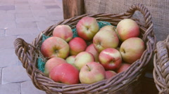 Red apples in a wicker basket, close-up Stock Footage