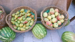 Autumn fruits in baskets (apples, pears), and next to them (watermelon) Stock Footage