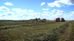 Farm Field. Working Farming Machines. Cut Grass Rows on the Ground. Red Truck Stock Footage