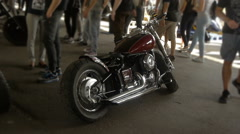 Stylish chopper, bike exhibition, motorcycles, back view Stock Footage