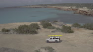 Aerial of car moving on beach Stock Footage