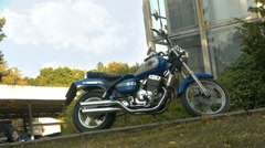 Blue Chopper parked near the building on the street, side view, close-up Stock Footage