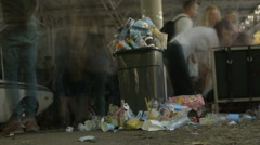 A pile of debris lying on the ground. People walk past the trash, timelapse Stock Footage