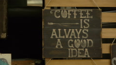 Wooden signboard in the cafe. Coffee, close-up Stock Footage