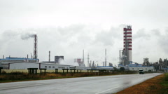 Power station. Smoke over the pipes. Straight Road Stock Footage
