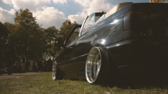Black car with an open top, a side view from below Stock Footage