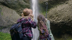 Hikers Use A Gopro And Pose For Selfies By A Waterfall Stock Footage