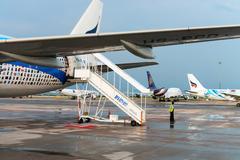 Bangkok Airways and Thai Airways airlines airplanes in Bangkok Airport. Stock Photos