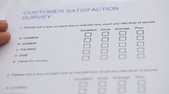 Filling The Customer Satisfaction Survey Form Stock Footage