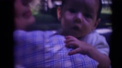 1947: mother holding baby boy in loving arms overlooking shoulder MIDDLETOWN Stock Footage