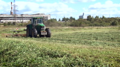 Rural Area. Farm Land. Tractor With Equipment Working on the Field, Cutting, Stock Footage