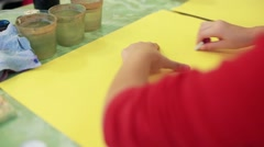 The girl draws a picture paints Stock Footage