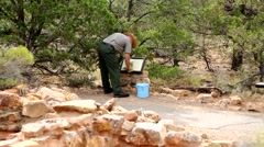 Park Ranger working at Tuasayan Ruins in the Grand Canyon Stock Footage