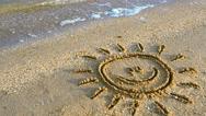 Sun drawing on the beach. Stock Footage