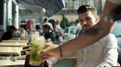 Man looking happy after waitress bringing him mojito Stock Footage