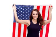 Happy young girl holding USA flag isolated on white background Stock Photos