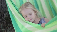 Smearing girl in hammock Stock Footage