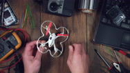 4k Technology Composition from Above of Drone Being Disassembled  Stock Footage