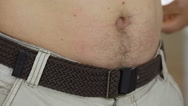Man Measuring Tummy With Tape Stock Footage