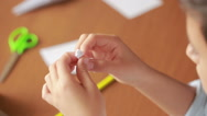 Little boy drawing on paper art origami. hobby crafts Stock Footage