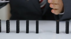 Businessman Hand Stop Dominoes Continuous Toppled Stock Footage