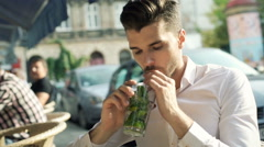 Man drinking mojito and receiving bad news on smartphone Stock Footage