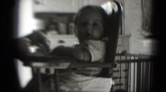 1947: baby in high chair staring off into space MIDDLETOWN Stock Footage