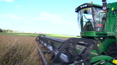 Countryside. Farming Land. Green Field by the Meadow. Combine Moving By, Cuting Stock Footage
