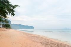 Tranquil and sandy tropical beach in Krabi Stock Photos