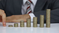 Businessman Walking His Fingers Over The Coins Stack Stock Footage