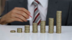 Businessman Protecting House Model And Coins Stack Stock Footage